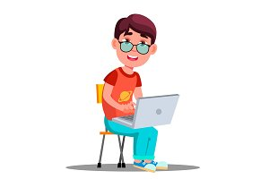Child In Glasses At The Laptop