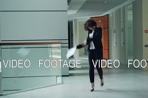 Carefree office worker is dancing in