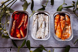 Three cans of sardines on sackcloth