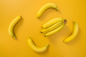 Bananas on bright yellow background