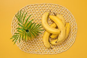 Ripe bananas and palm leaves