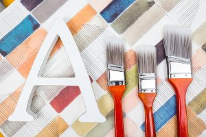 Paint brushes and letter A