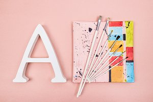 White letter A and paintbrushes