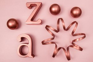 Copper decorative objects on pink bg