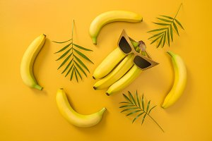 Bananas, sunglasses and palm leaves