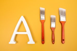 Letter A and red paintbrushes