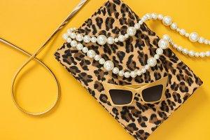 Fashion accessories on yellow bg