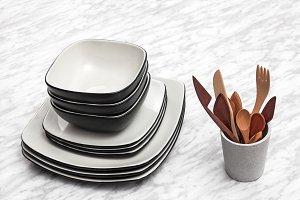 Ceramic plates and wooden utensils