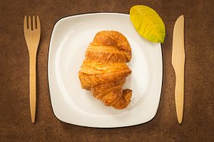 Croissant on a plate, autumn mood