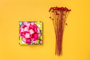 Bright gift box and red flowers