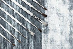 Paintbrushes on artistic background