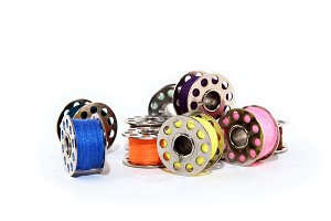 Pile of colorful thread spools