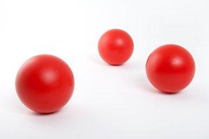 Red balls on white background