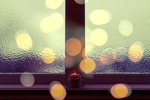 Frosted window in dark evening light