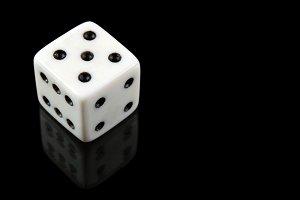 White dice on black background