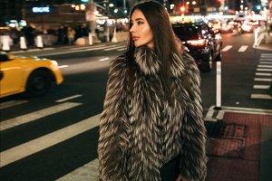 woman walking on night city street