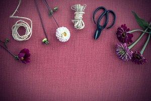Florist workspace on purple canvas