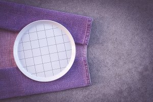 Checked white plate and purple cloth
