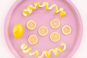 Lemons and spiral peel on a tray