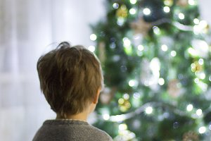 The boy near the Christmas tree