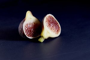 Fresh figs on black background