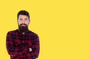 Hipster man with big beard on a yell