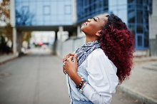 Attractive curly african american wo by  in Beauty & Fashion