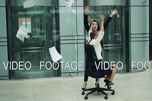 Slow motion of excited businesswomen