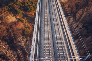 Aerial view of train tracks on a bri
