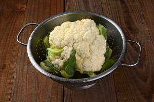 Cauliflower in Colander Wood Table