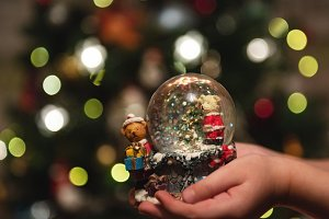 snow glass ball in the hands