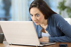 Perplexed woman reading online news