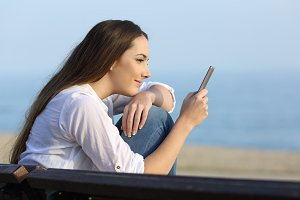 Relaxed girl watching phone content