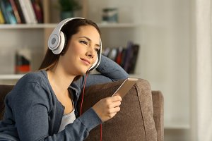 Relaxed woman listening chillout mus