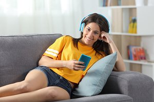 Teen listening to music looking at c