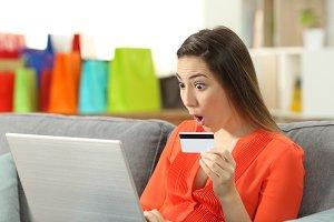 Surprised lady buying online paying