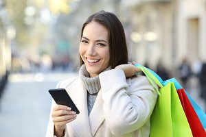 Shopper holding a phone and shopping