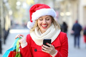 Shopper checking phone on christmas