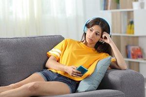 Serious teen listening to music onli