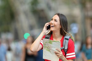 Teen tourist calling on phone in the
