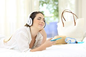Woman listening to music relaxing in