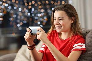 Teen watching media in a smart phone