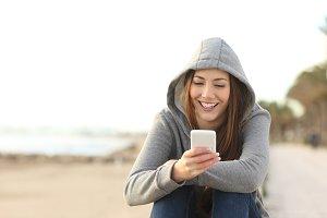 Teenage girl using a smart phone on