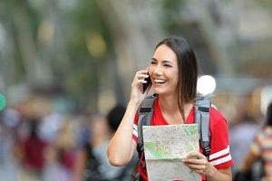 Teenage tourist talking on phone in