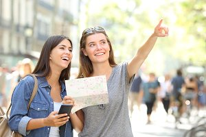 Tourists sightseeing holding a map a