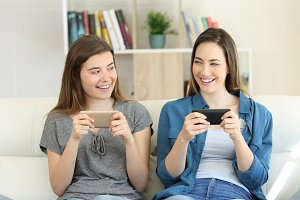 Two friends playing on-line with the