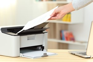 Woman hand catching a document from