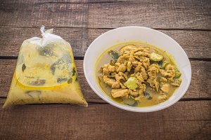 Thai curry in plastic bag and bowl