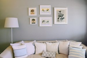 Cozy couch and photo frame art