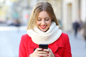 Woman reading phone messages in the